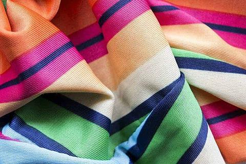 A close up of a colorful viscose scarf.