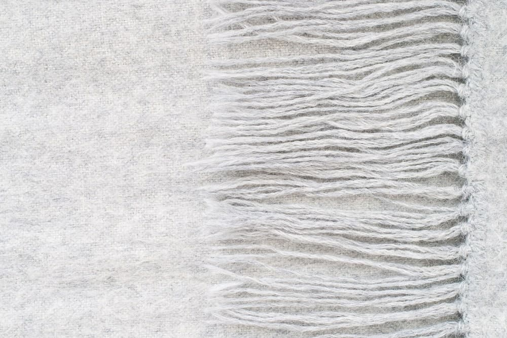A close look at a gray alpaca wool scarf.