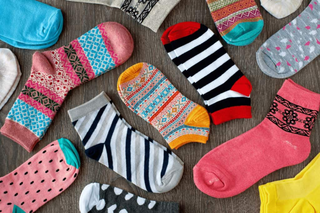 A variety of colorful patterned socks for women.