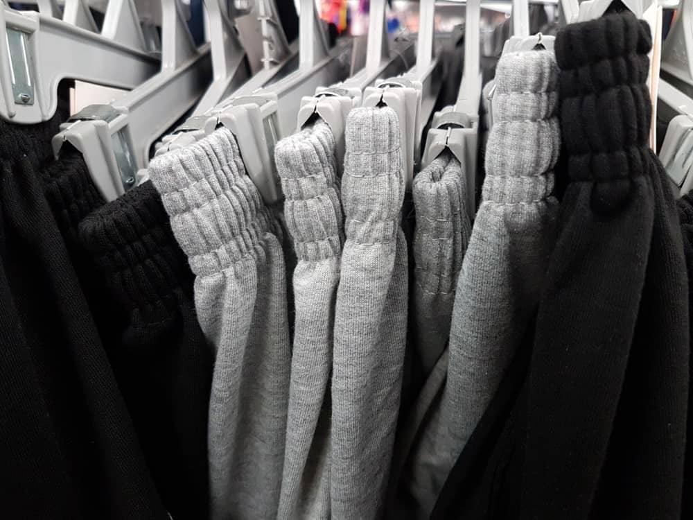 Gray and black sweatpants on display at a shop.