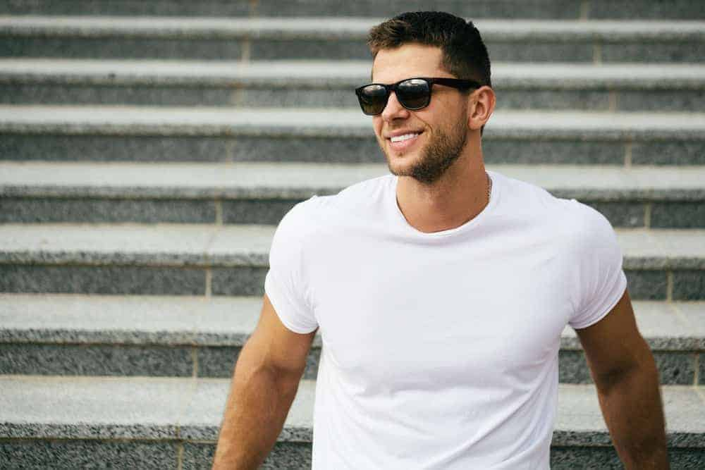 A man sporting a white T-shirt.