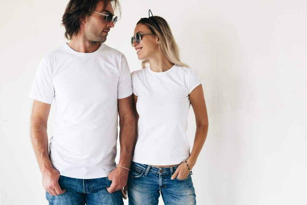 A couple wearing white shirt and jeans.