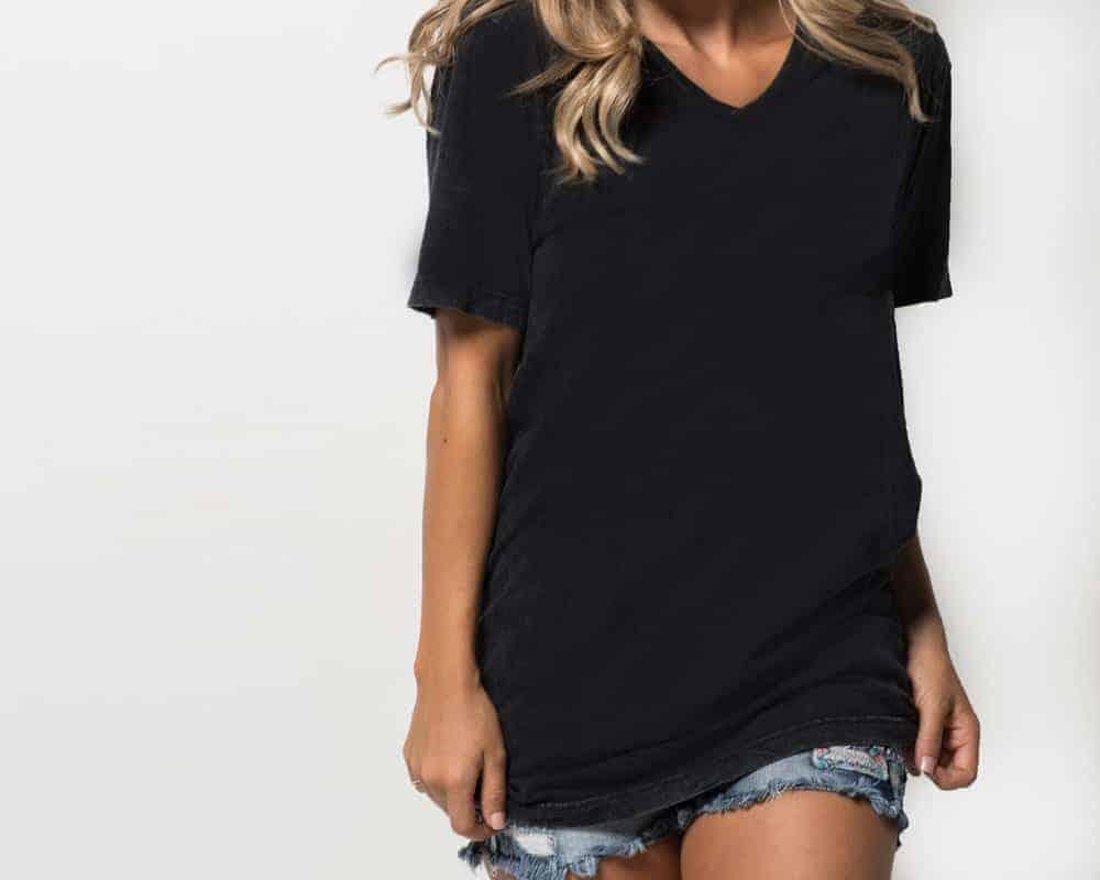 Woman wearing a black V-neck T-Shirt and short shorts.