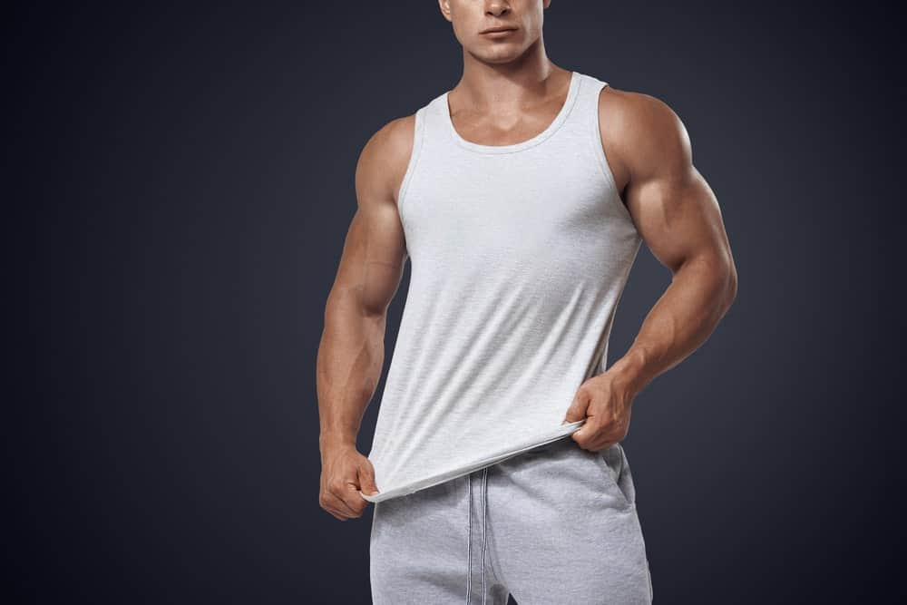 A man wearing a white tank top.