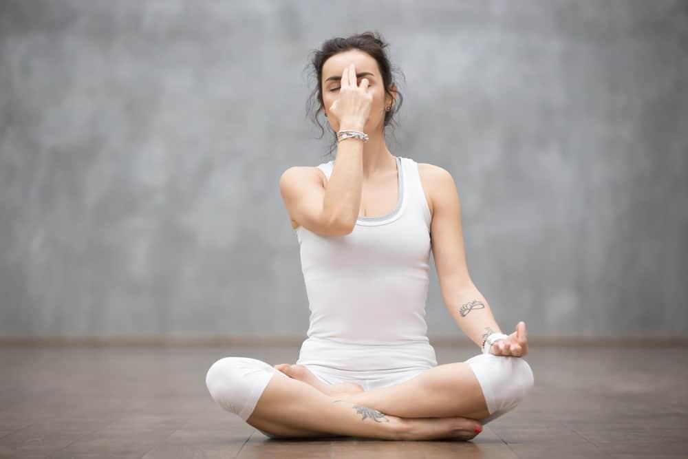 Woman on a meditative pose.