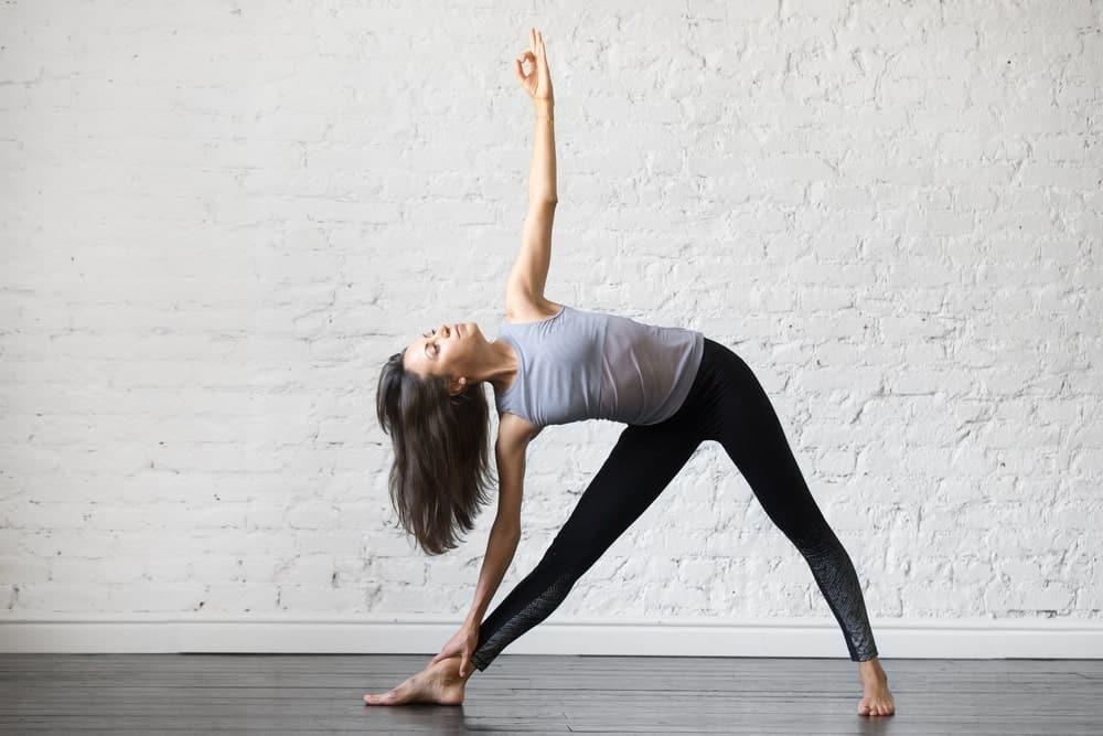A woman doing a yoga pose.