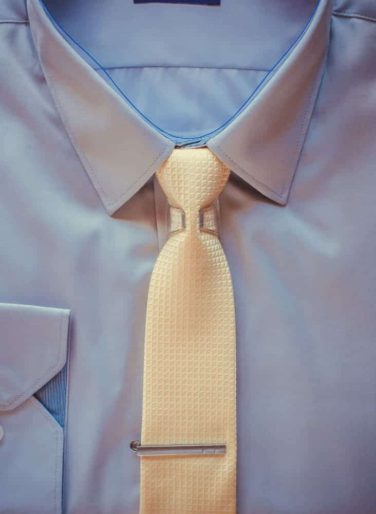 A clip on tie worn with a suit.