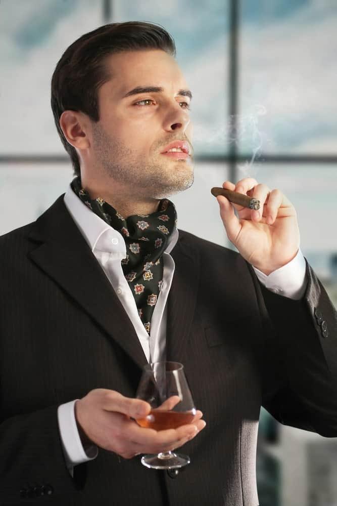 A stylish man wearing an ascot necktie.