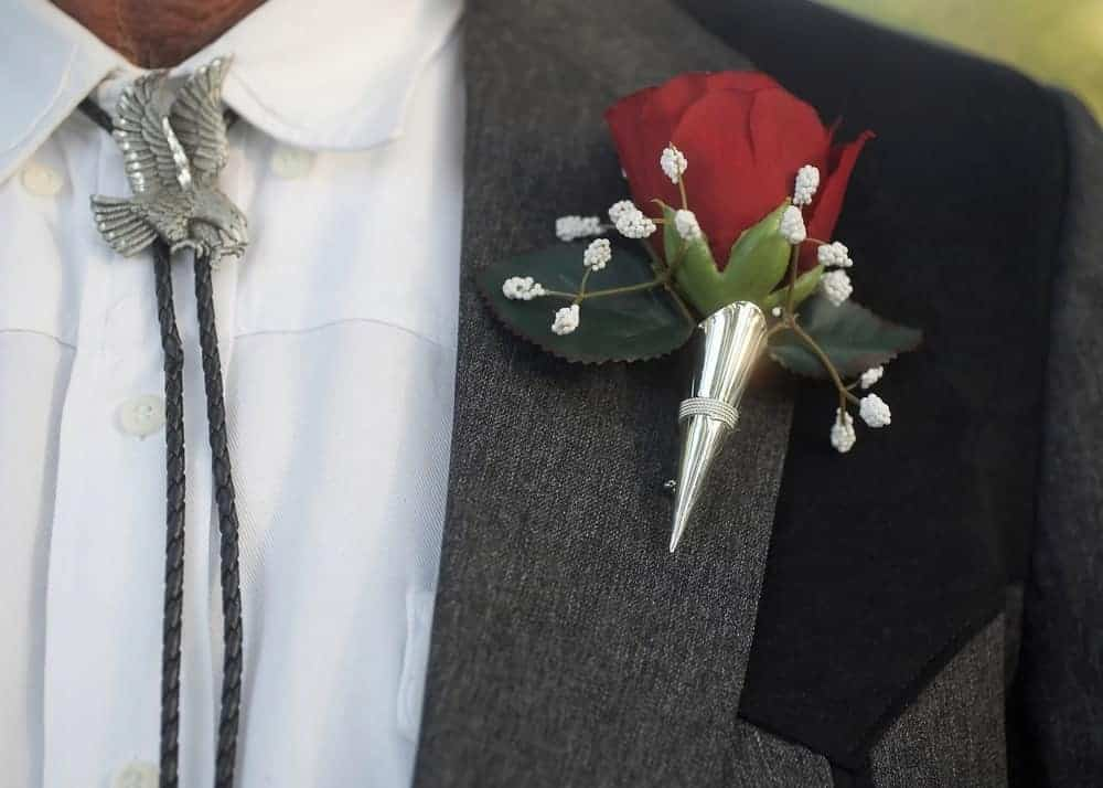 A close look at a man wearing a bola tie at a formal event.