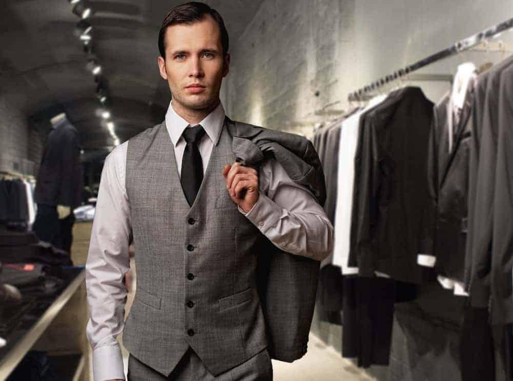 A businessman wearing a vest.