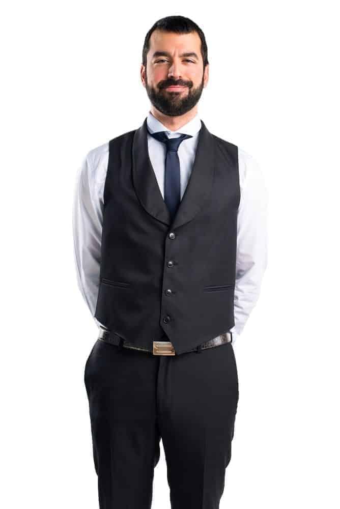 A man wearing a black tuxedo vest.