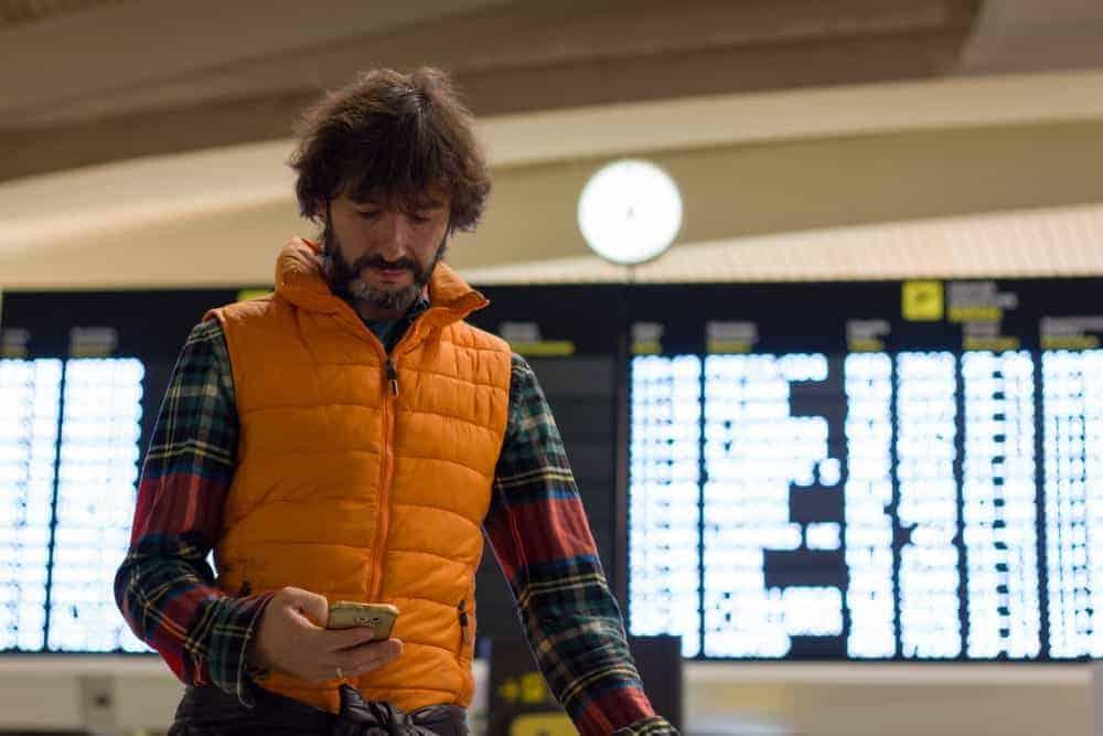 A man wearing a puffer vest.