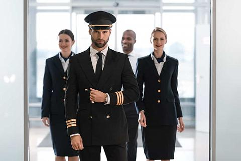 A pilot in uniform with his team.