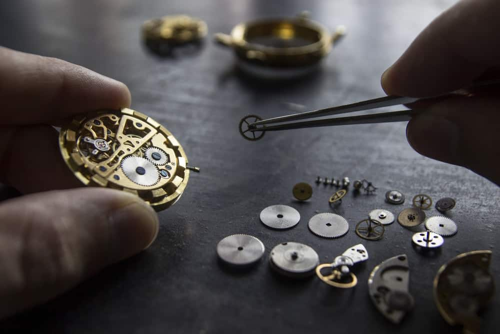 A close inspection of how a watchmaker dismantles a watch.
