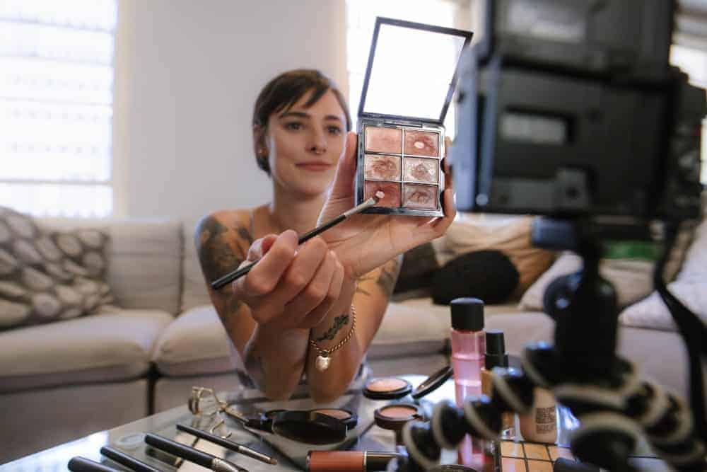 Woman teaching makeup on a YouTube blog.