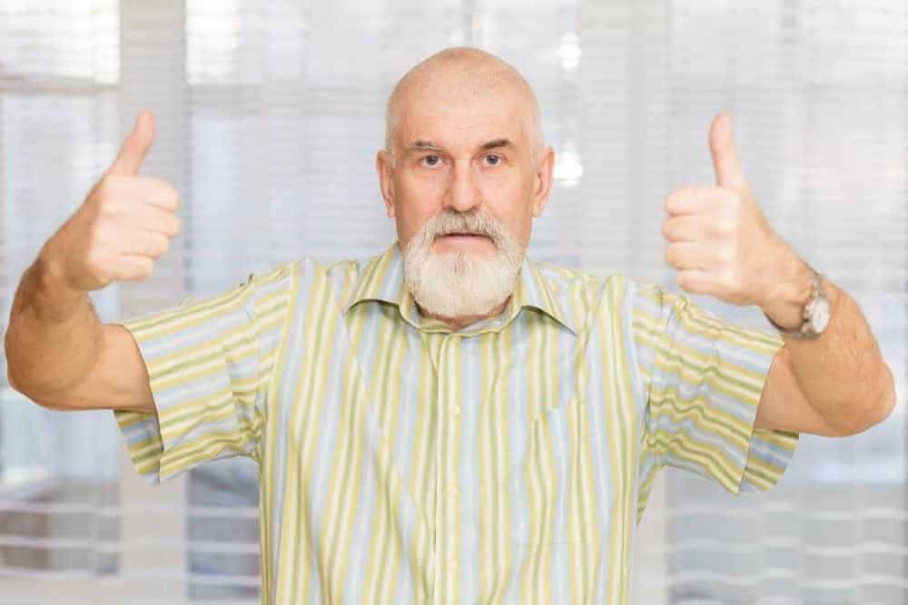 Bald old man in a yellow-striped short sleeves shirt.