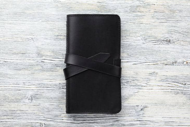 Checkbook wallet in black.