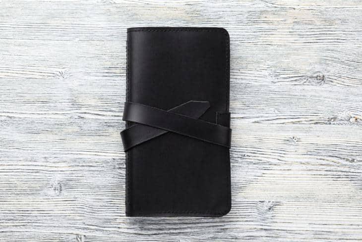 Checkbook wallet in black.