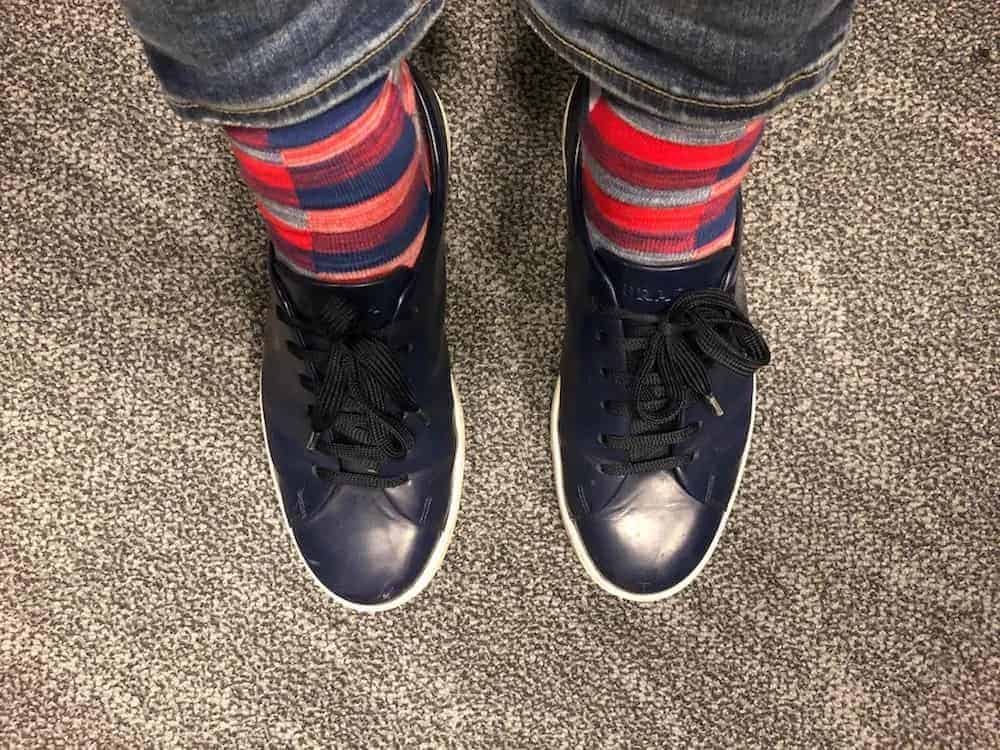 Blue Prada shoes with colorful socks.