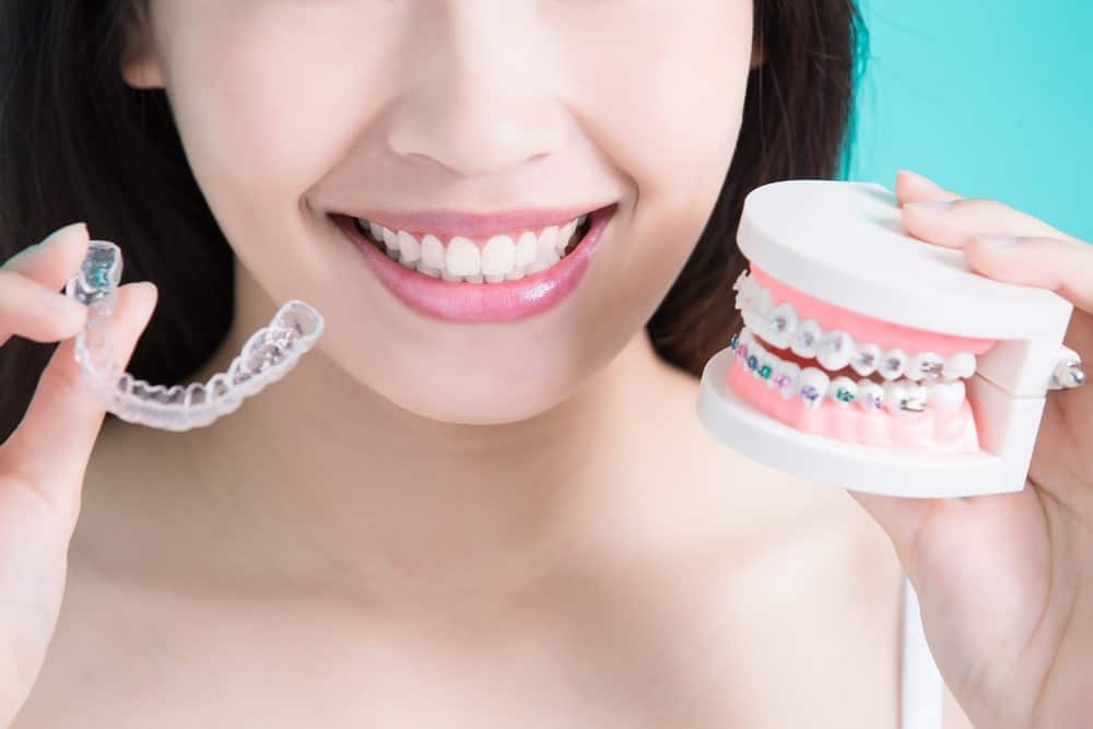 A woman making a choice between having braces or something simpler.