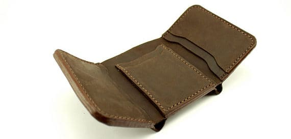 Khaki brown leather wallet with three folds.