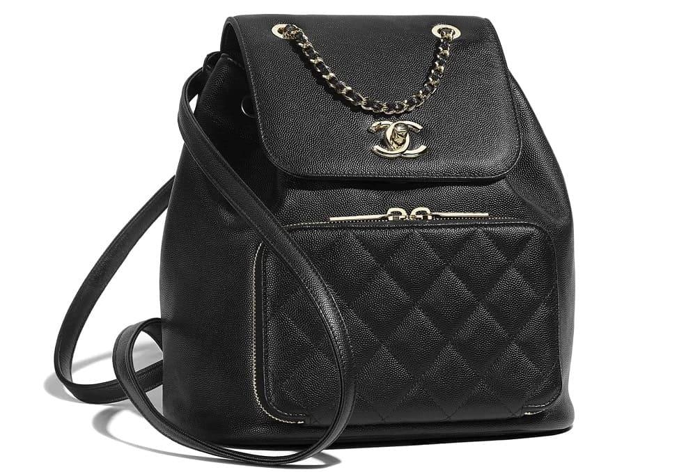 Chanel grained calfskin backpack in black.