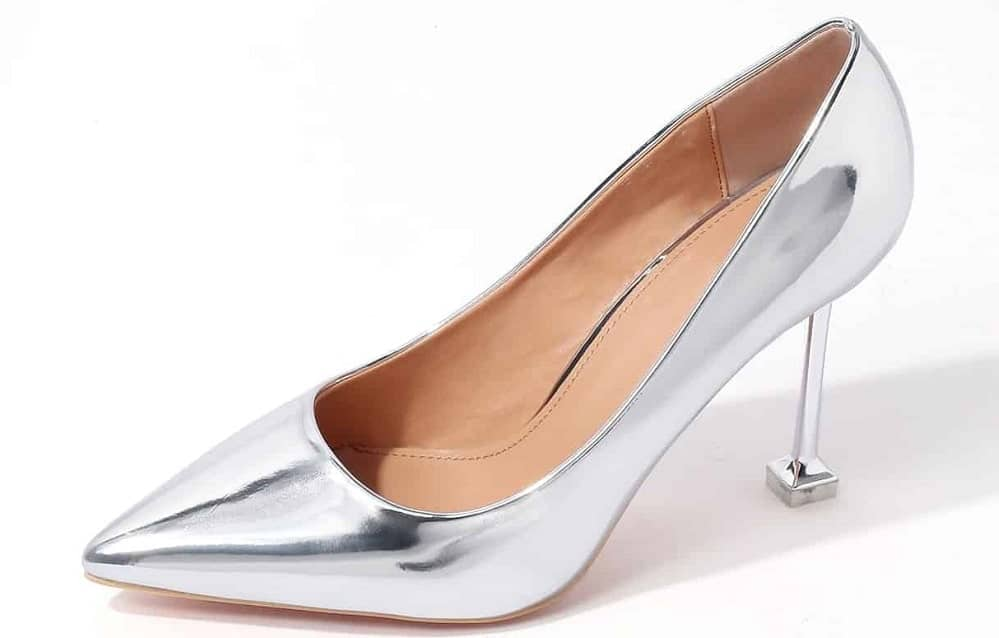 A silver shoe with comma heel.