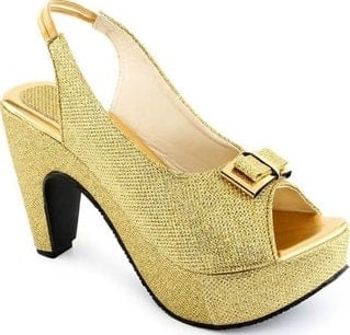 A close look at a yellow shoe with cone heel.