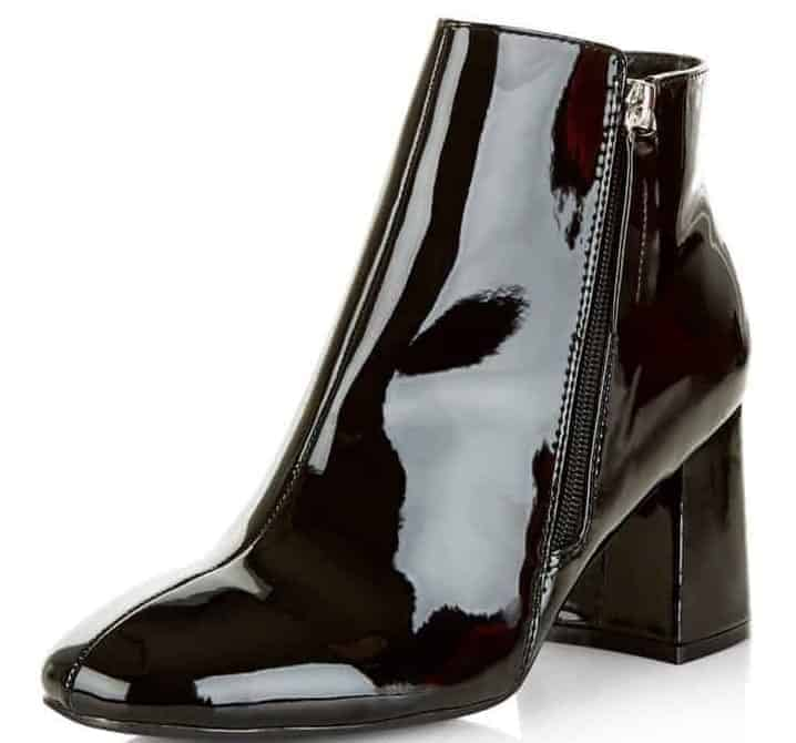 A black shoe with Flare Heel.