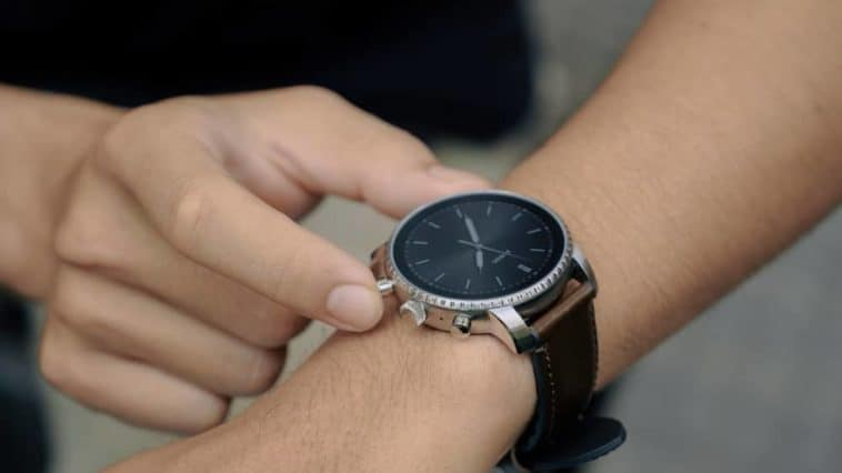 A close look at a man sporting a Fossil smartwatch.