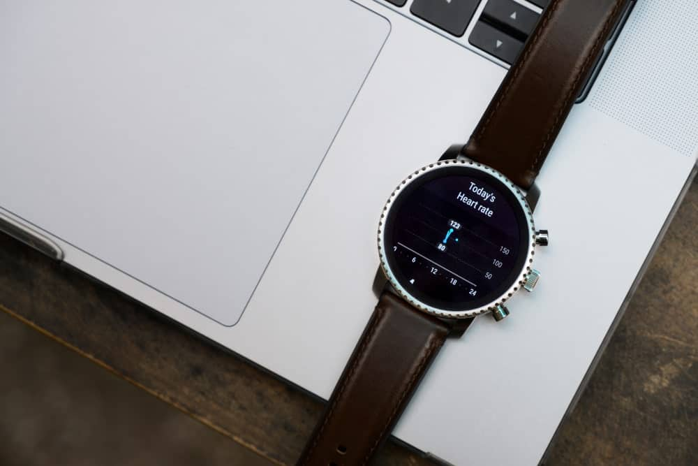 A Fossil smartwatch on a laptop.