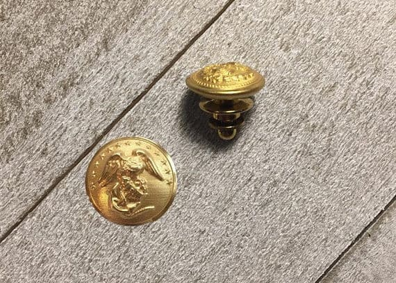 A pair of USMA cadet, Gold label button.