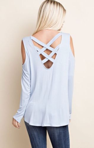 Light blue top with a criss-cross back design.