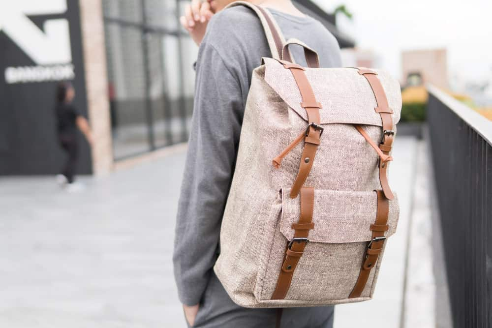 Man wearing a gray backpack.