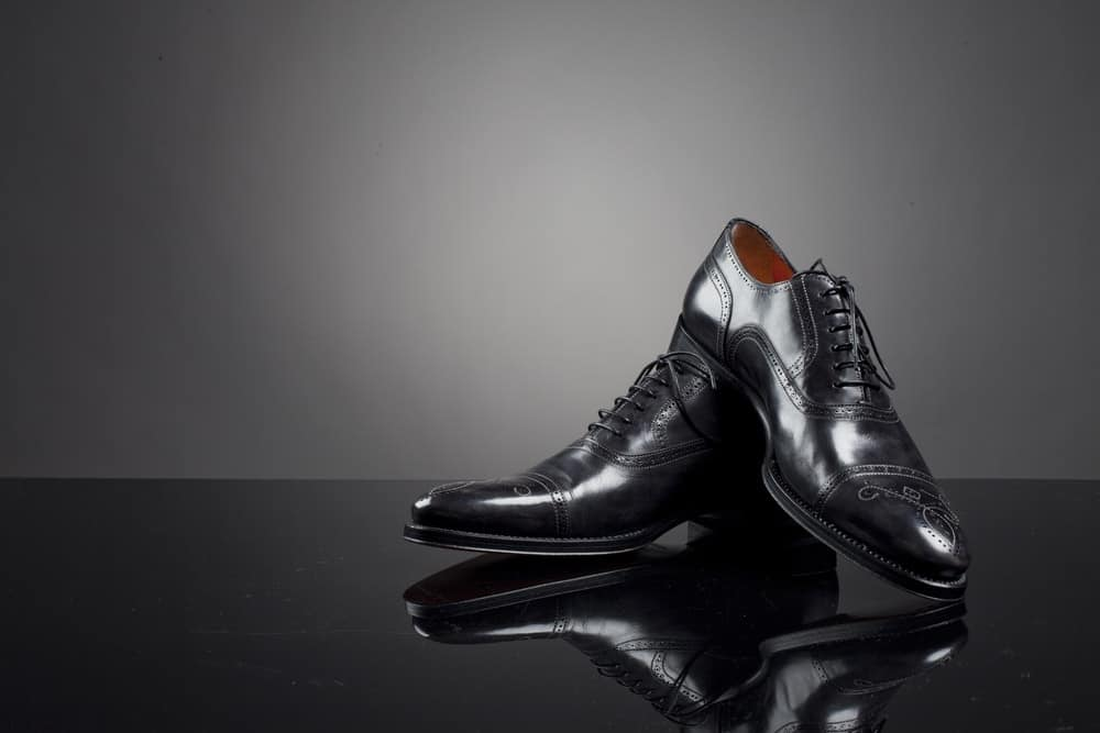 A pair of expensive black leather shoes for men.