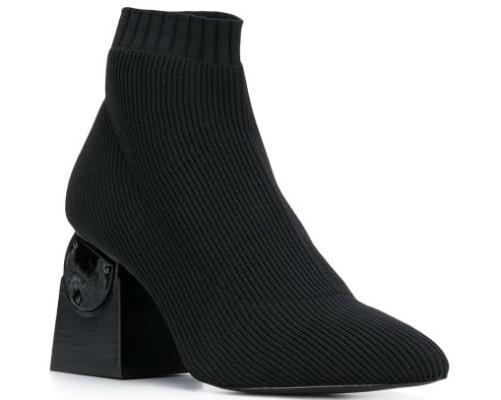 A black shoe with a sculptural heel.