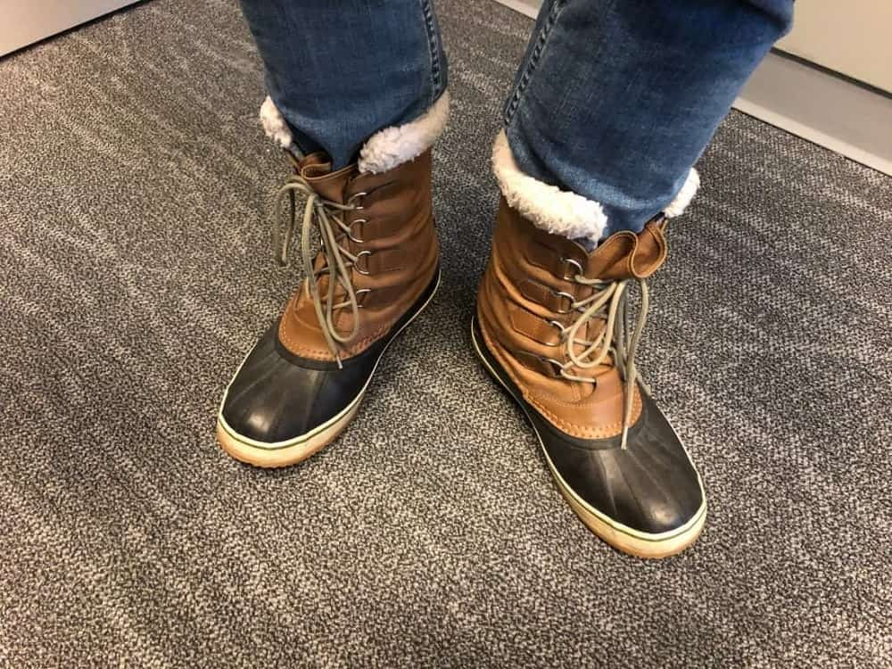 Photo with Sorel Caribou boots with jeans tucked in.