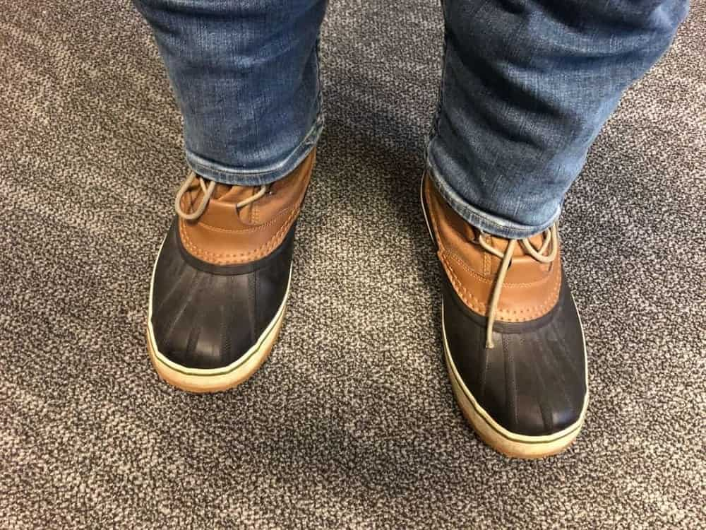 Photo of Sorel Caribou boots with jeans un-tucked.