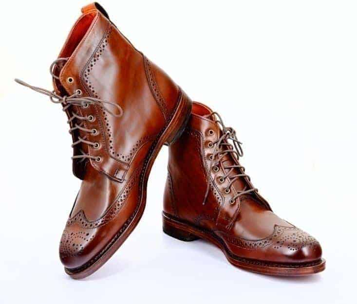 A pair of tan Brogue Wingtip Boots.
