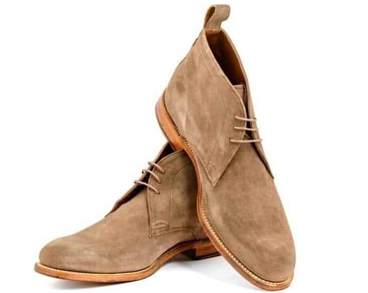 A couple of Light Brown Chukka Boots.