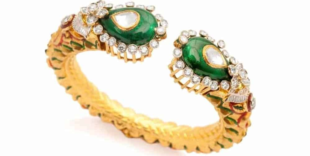 Designer bracelet made out of gold with diamonds.