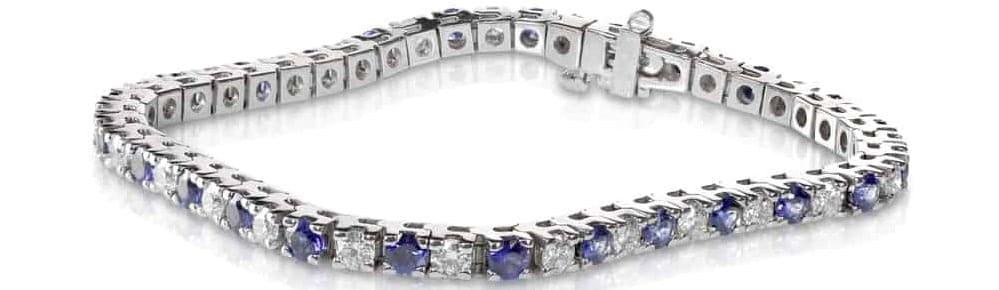 A silver Tennis bracelet with stones.