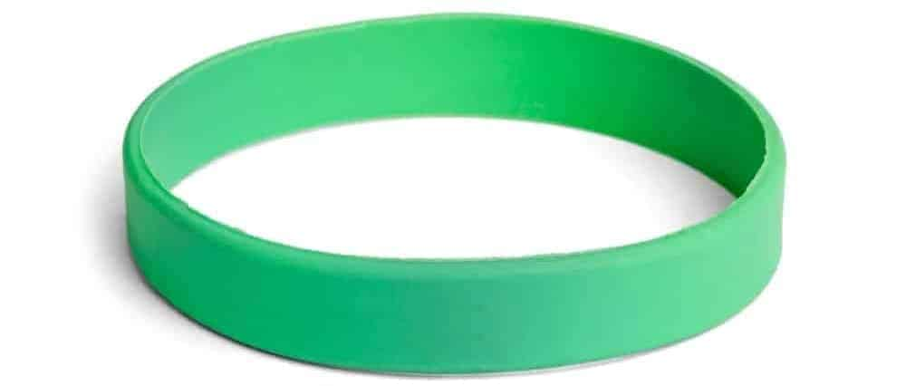 A look at a single green plastic/silicone bracelet.