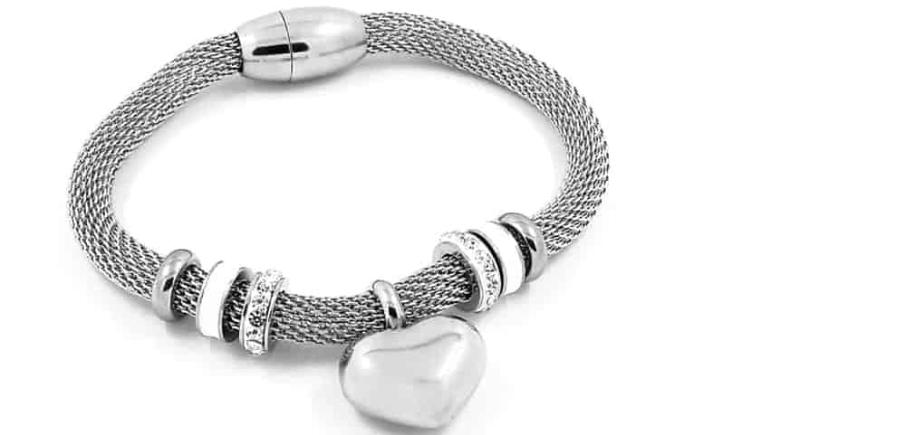 A look at a Stainless steel bracelet with a heart charm.