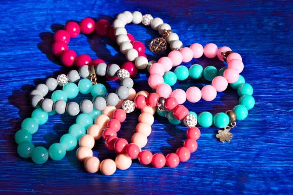 Several beaded bracelets of different colors.