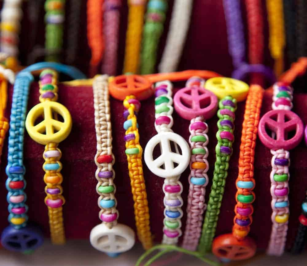 A bunch of colorful braided bracelets .