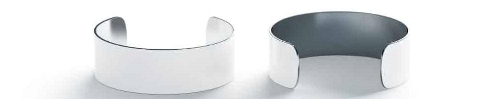 A couple of white Cuff bracelets.
