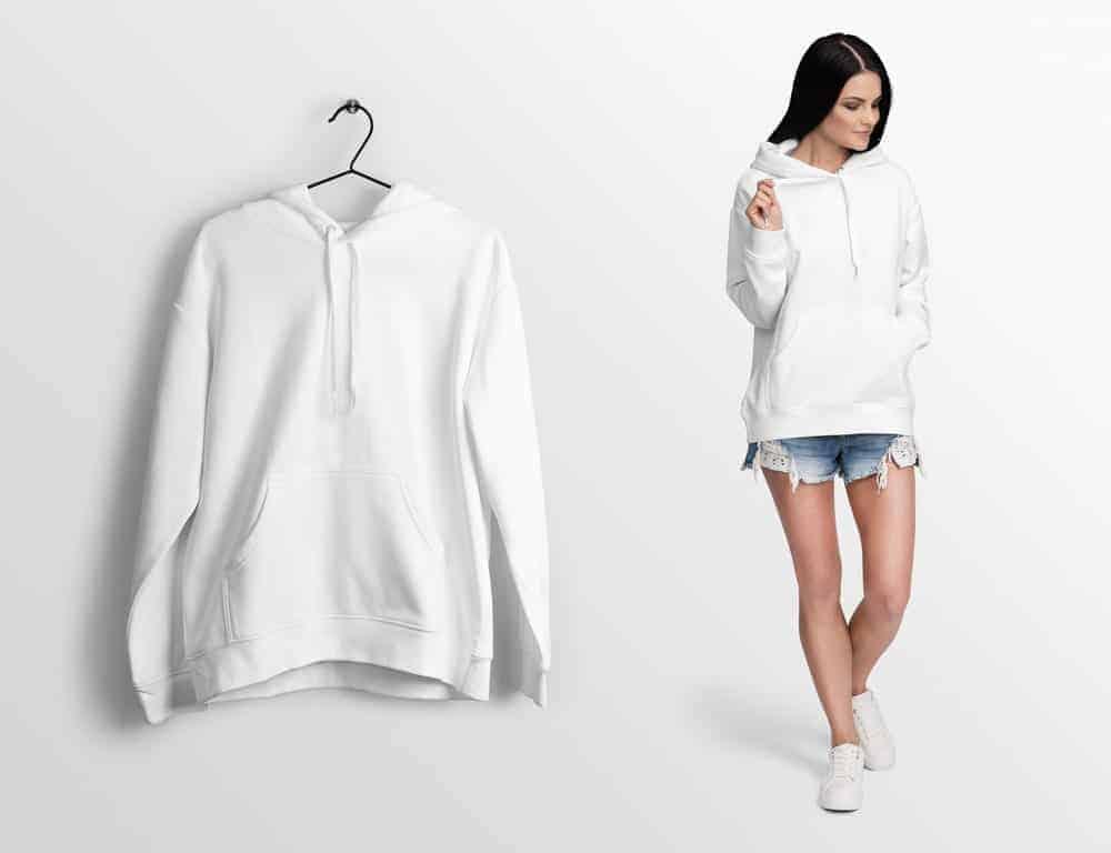 A white hoodie worn by a woman.