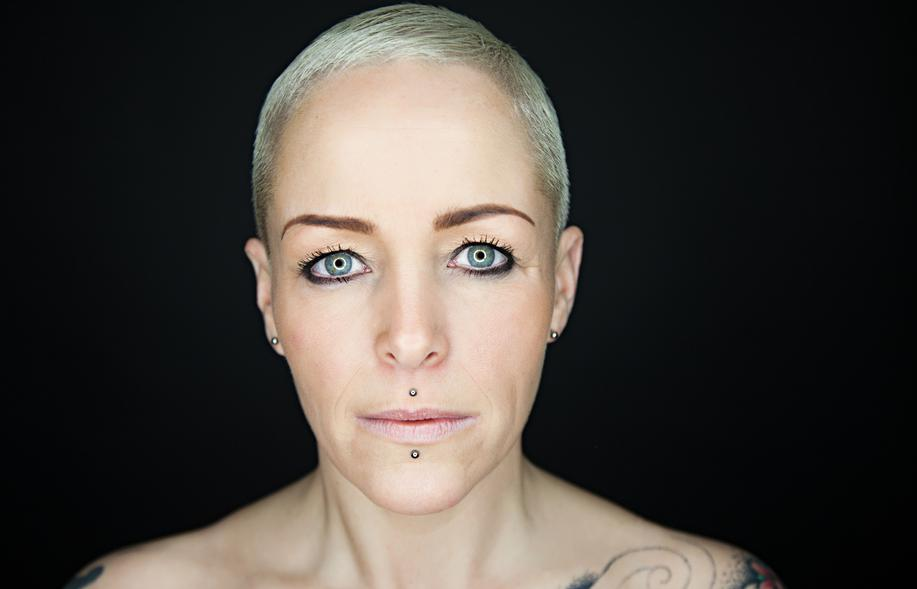 A middle-aged woman with a cyber bite piercing.