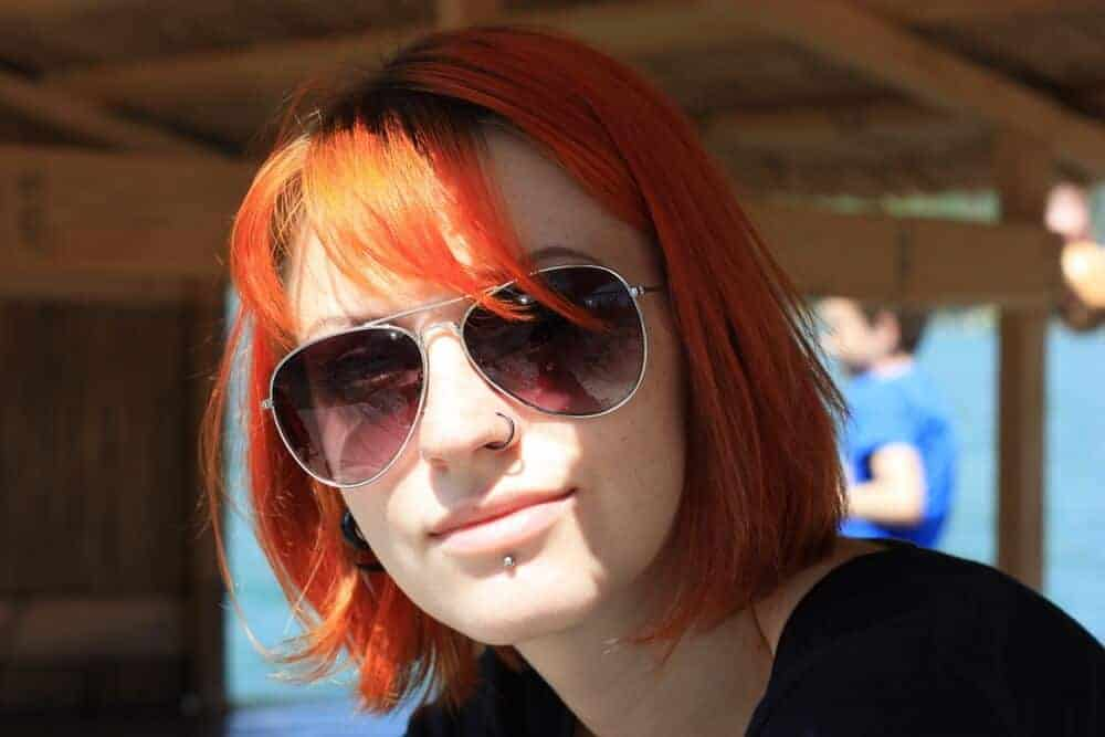 A girl wearing her labret piercing outdoors.